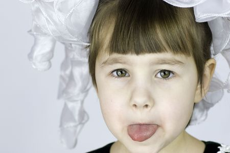 Close up portrait of a Grimacing child photo