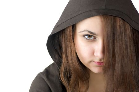 Angry Teenager with brown eyes wearing hood hiding face behing hair