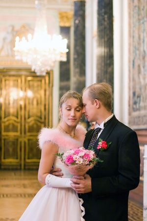 Bride and groom romance indoors photo