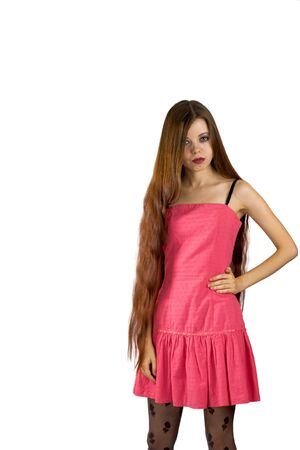 Portrait of a Beautiful pensive brunette woman wearing pink dress isolated on white photo