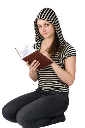 Teenage girl wearing striped hood looking at organizer on friday 13 photo