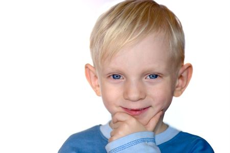 Portrait of A smiling boy with blue eyes isolated o white photo
