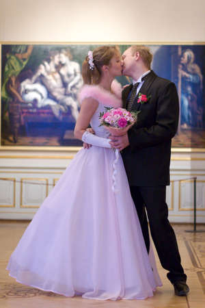 Bride and groom kissing indoors over picture background Stock Photo - 2629114