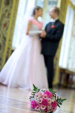 Bride and groom romance indoors photo