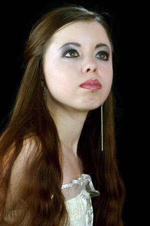 Portrait of a Beautiful pensive brunette woman looking up photo