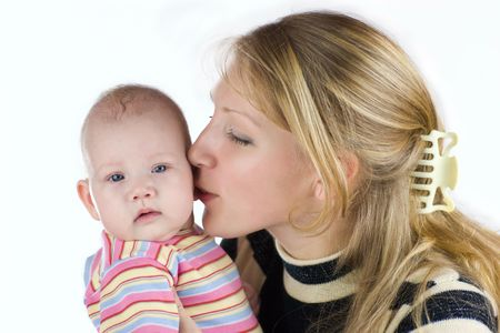Mother kissing her baby isolated on white Stock Photo - 2634895