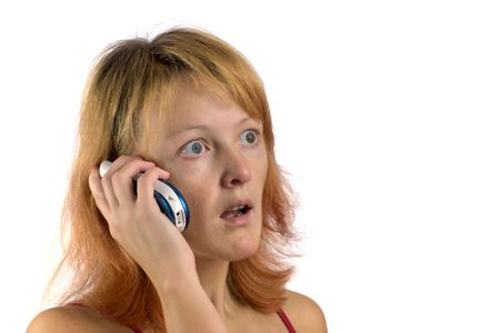 Shocked woman talking on phone isolated on white photo