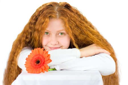 Portrait of happy woman with gerbera isolated on white photo