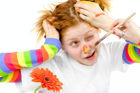 Funny artist going to paint something on friend's face Stock Photo - 2911340