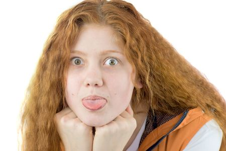 Funny redhair girl showing tongue isolated on white photo