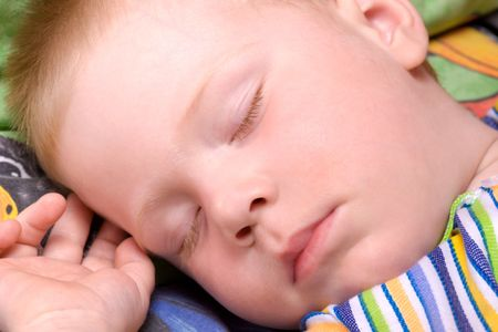 Sleeping child close up face portrait photo