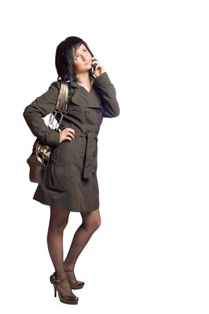 Stylish young woman talking on mobile phone isolated on white Stock Photo - 3069851