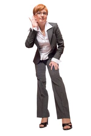 Young business woman listening isolated on white photo