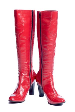 Red beautiful shining modern boots isolated on white photo
