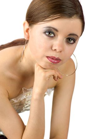Beautiful young brunette woman with huge earrings isolated on white photo