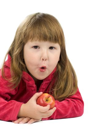 Cheerful kid holding apple with funny face isolated on white Stock Photo - 3219195