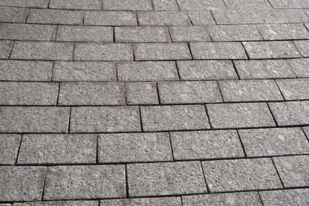 street background made of grey granite stones photo