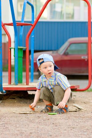 Boy on playground looking up summer sunny day photo
