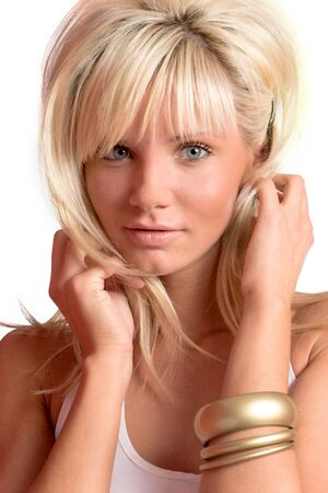 Young blond woman wearing white top isolated on white