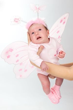 Baby in age of one month dressed as butterfly