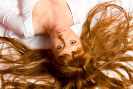 Seductive sexy gorgeous womanl lying on the floor upside down looking at you photo