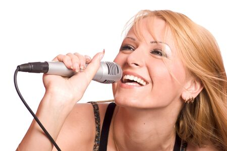 Young beautiful blond girl singing isolated on white