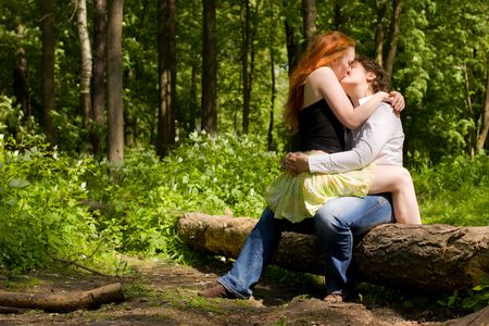 Two Girlfriends kissing in summer forest vacations Stock Photo