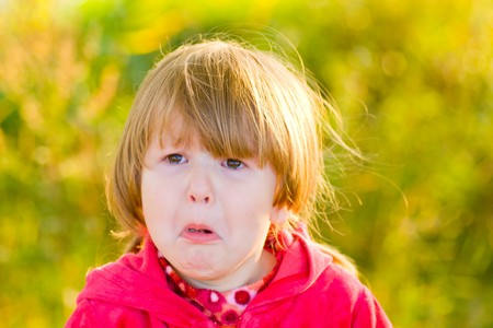 Crying 4 years girl looking away outdoors Stock Photo - 4124621
