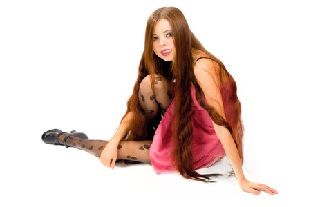 Pretty young woman wearing pink dress and long hair isolated on white photo