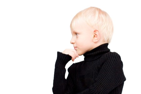Pensive Serious boy with blond hair isolated photo