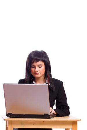Young business woman Working on laptop isolated on white photo