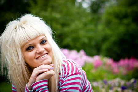 Happy young blond woman looking at you Stock Photo - 5101535