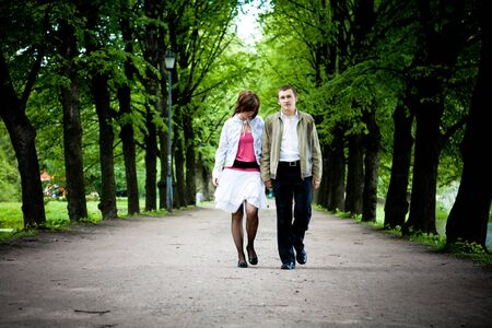 Happy young couple walking through valley in park  Stock Photo - 5101534