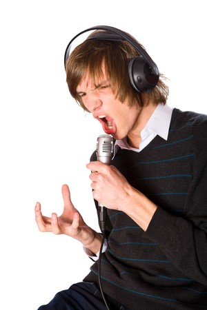 Young man singing wearing headphones isolated on white photo