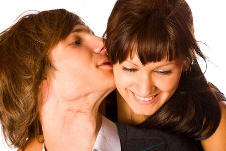 Young beautiful teenage couple sharing a secret photo