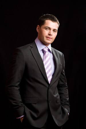 Young man wearing suit with tie