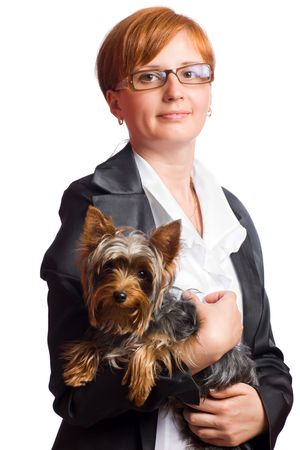 Business woman holding yorkshire terrier isolated on white photo