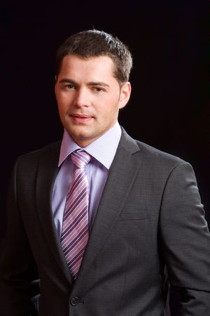 Young business man wearing suit with tie photo