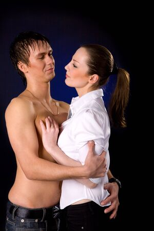 hot wife: Hot couple in the middle of something over dark background