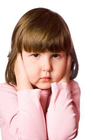 shutting: Scared little girl Shutting ears isolated on white