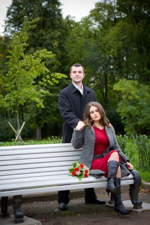 Portrait of Young Couple in spring park together photo