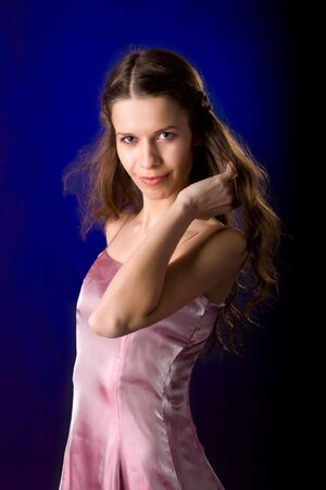 Portrait of Young woman in over dark blue background Stock Photo - 5103103