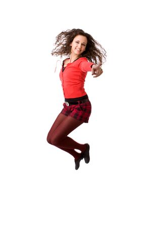 Young cheerful brunette woman jumping isolated on white Stock Photo - 5103161