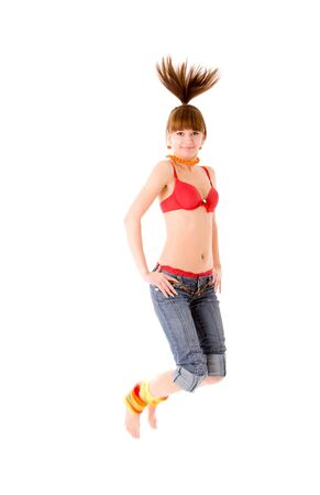 Jumping teenage girl wearing vivid clothes photo