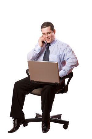 Portrait of Happy Businessman talking on mobile and typing isolated photo