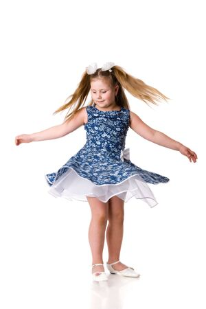 pirouette: Cheerful girl spinning on floor isolated on white