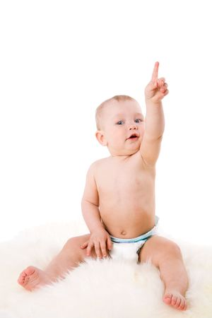 Baby pointing up sitting on fur isolated on white Stock Photo - 5103774