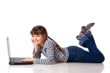 10's: School Girl with laptop surfing the net isolated on white