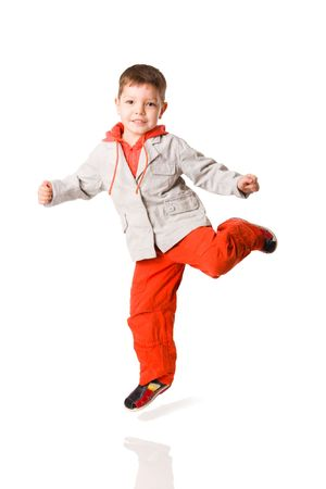 Jumping boy wearing vivid pants isolated on white Stock Photo
