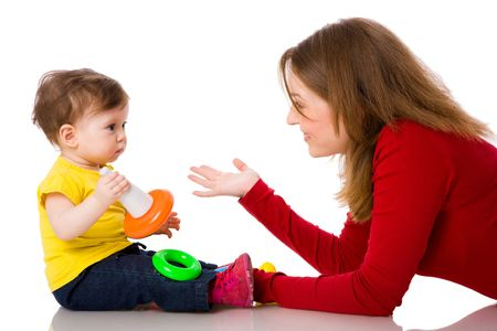 Mother playing with one year daughter isolated on white photo